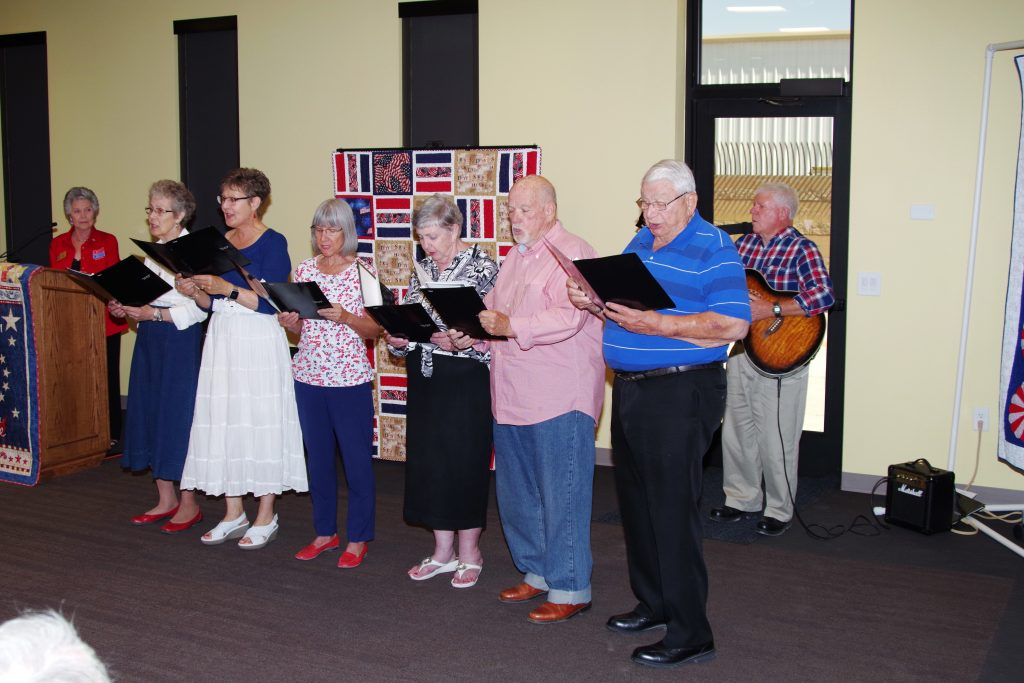 Volunteer members of the PVUMC sing during QOV ceremoney June 9th