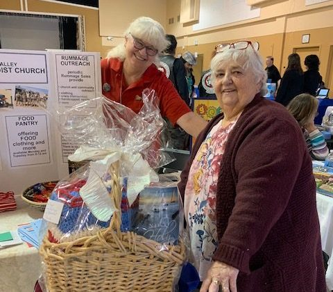 Pastor Lana congratulates the recipient of a gift basket