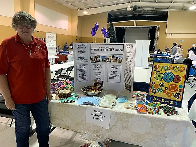 Barb in front of the PVUMC table at the Social Services Fair 2019